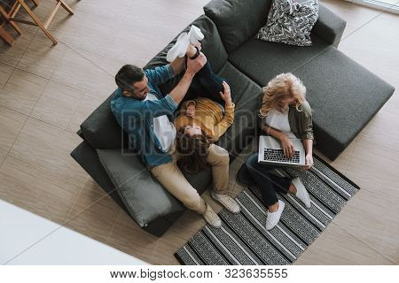 Loving Parents Spending Time With Their Adorable Kid At Home