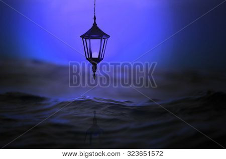 Street Vintage Lantern Over The Sea On A Blue Background.