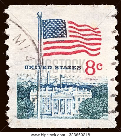 United States - Circa 1967: Stamp Printed By United States, Shows Flag Over White House In Washingto