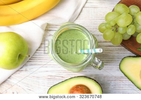 Flat Lay Composition With Tasty Avocado Smoothie On White Wooden Table
