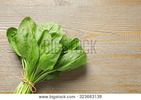 Bunch Of Fresh Green Healthy Spinach On Wooden Table, Top View. Space For Text