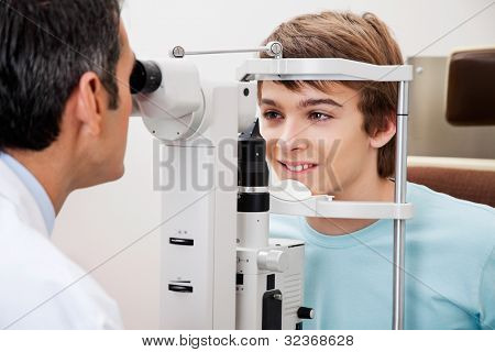 Measurement of peripheral vision done by optometrist while performing visual field test