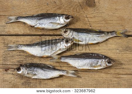 Close-up Dried River Fish On Old Wooden Background