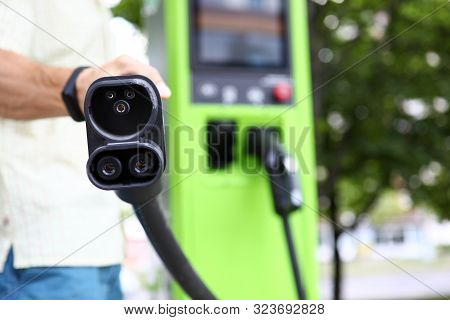 Focus On Modern Charge Device For Automobile. Auto Filling Station For Electro Vehicle. Environmenta