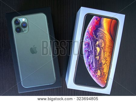 Dubai / Uae - September 21, 2019: Two Boxes Of New Apple Iphone 11 Pro And Iphone Xs On Wooden Backg