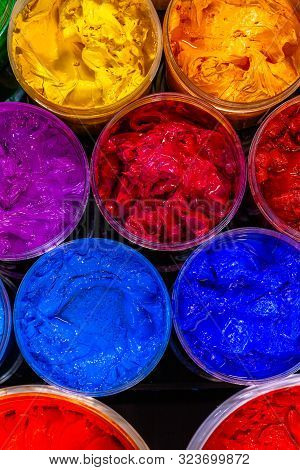 Several Color Plastisol Ink Cans In Factory Who Use Plastisol Ink To Print Tee Shirt And Print On Fa