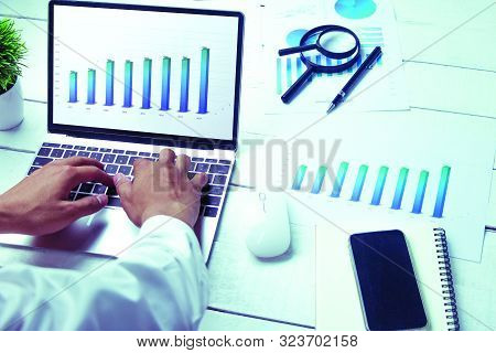Graphs And Charts Elements On Laptop Computer Screen  And Statistical Performance Of The Company In