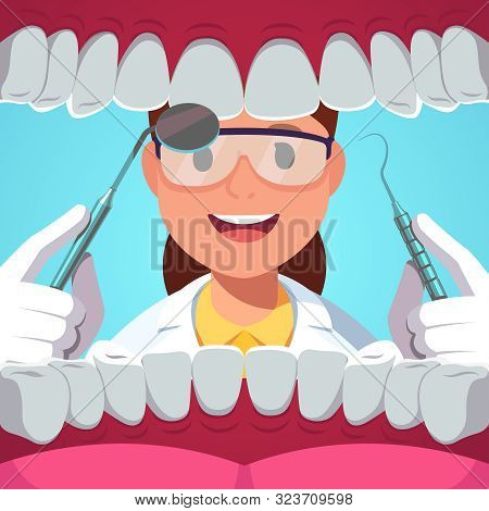 Dentist Woman With Tools Examining Patient Teeth