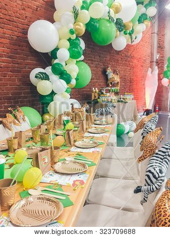 Perm/ Russia - May, 20, 2019: Safari Party Candy Bar. Delicious Sweet Buffet. Celebratory Table. Cat