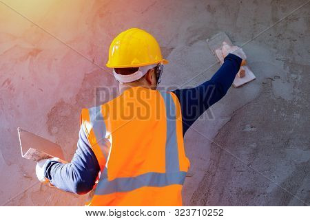Workers Plastering The Wall Indoors,workers On The Construction Site, Construction Sites Against The