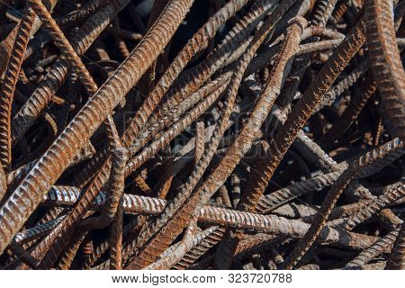 Industrial Background. Rebar Texture. Old Rusty Rebar For Concrete Pouring. Steel Reinforcement Bars