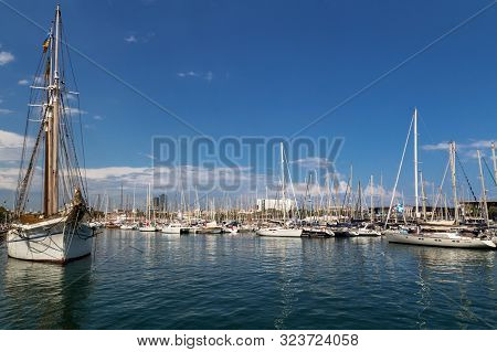 Barcelona, Spain - July 9, 2019: Picturesque City Port. Famous Port Vell. Beautiful White Yachts And
