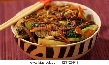Asian Dish Yakisoba Served In A Bowl With Sticks On Top Close Up