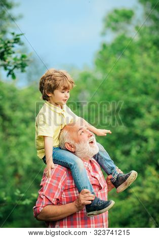 Grandfather And Grandson Playing In The Park At The Day Time. Funny Time With Grandfather. Happy Joy