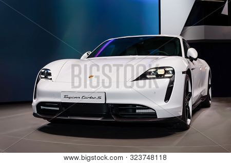 Frankfurt - Sep 15, 2019: White Porsche Taycan Turbo S Is The First Fully Electric Sports Car From P