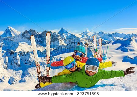 Happy family enjoying on snow winter vacations in mountains