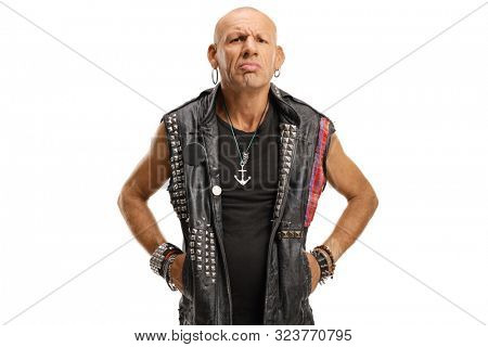 Portrait of a serious middle-aged bald punk in a leather vest isolated on white background