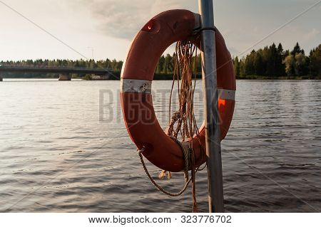 A Lifebelt Hanging By A Lake On An Early Autumn Morning At The Northern Finland. The Sun Is Slowly R