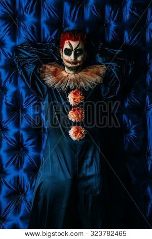 A portrait of an angry clown from a horror film. Halloween, carnival.