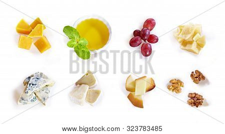 Different Type Of Cheese With Honey, Grape, Nuts On White Background. Top View. Blue Cheese, Cheddar