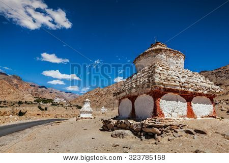 Whitewashed chortens Buddhist stupas near Likir monastery. Ladakh, India