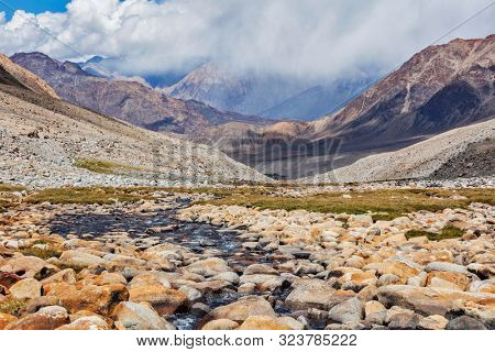Mountain stream in Himalayas near Kardung La pass. Ladakh, India