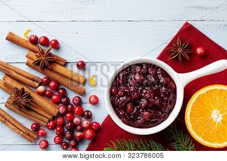 Cranberry Sauce In Ceramic Saucepan With Ingredients For Cooking Decorated With Fir Tree For Christm