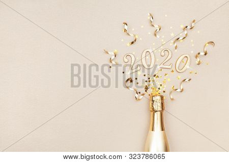 Creative Christmas And New Year Composition With Golden Champagne Bottle, Party Streamers, Confetti