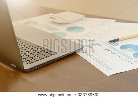 Business Report Show In Laptop Digital Tablet