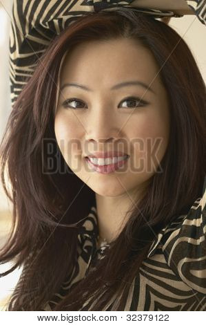 Close up of young Asian woman smiling