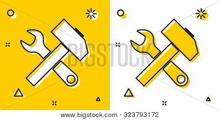 Black Crossed Hammer And Wrench Icon Isolated On Yellow And White Background. Hardware Tools. Random