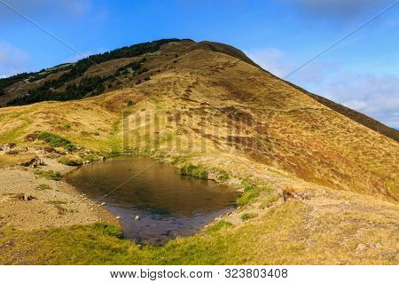 Small Lake At The Top Of Strymba Mountain On A Beautiful Autumn Day Near The Village Of Kolochava, U