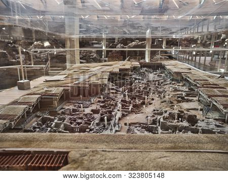 Santorini, Greece  - July 29 2019 Scale Model Of The Recovered Stone Ruins Of Antique Civilization U