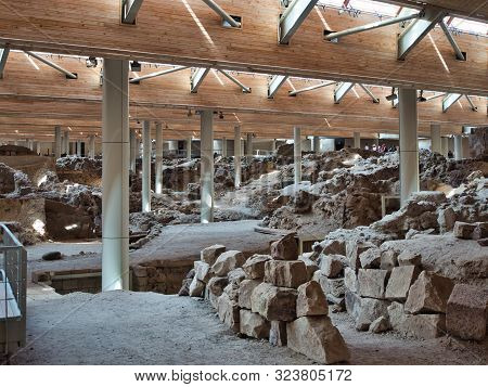Santorini, Greece  - July 29 2019 Archaeological Excavations Of Antique Building With Stacked Stones