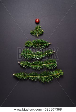 Christmas Greeting Card. Stylized Christmas tree on a black background