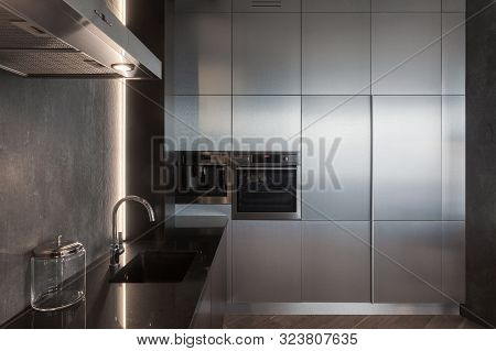 Black Kitchen With Extractor Hood, Contemporary Household Appliance, Sink, Chrome Water Tap On Workt