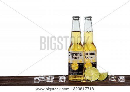 Dnipro, Ukraine - July 21, 2019: Corona Bottle With Lime Fruit Ready To Drink On White Background. C