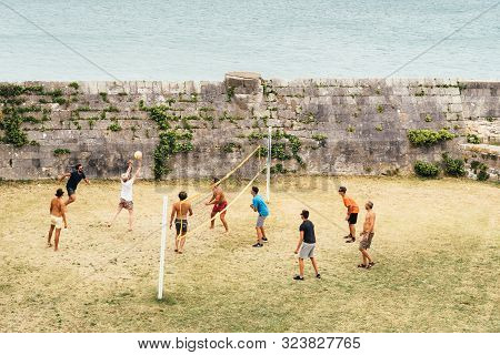Saint Martin De Re, France - August 7, 2018: Group Of Friends Play Volley Close To The Ocean In The