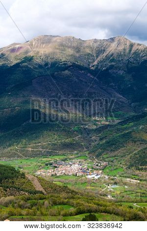 Small Village At The Foot Of A Mountain In The French Pyrenees