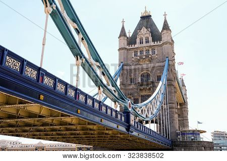 Tower Bridge In London With Bridge Lowered And Blue Sky