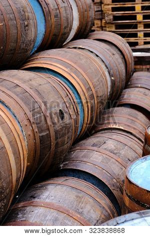 A Selection Of Wooden Barrels Used In Ethe Brewing And Distillery Industry