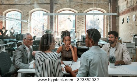 Important Meeting. Group Of Business People Discussing Something And Working Together While Sitting