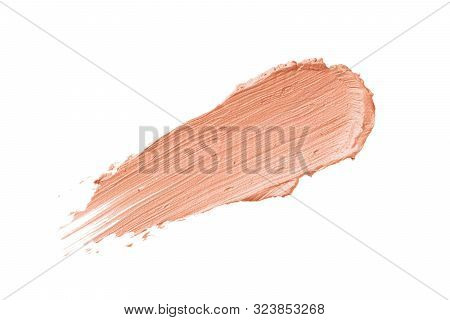 Color Corrector Stroke Isolated On White Background. Peach Pink Color Correcting Cream Concealer Smu