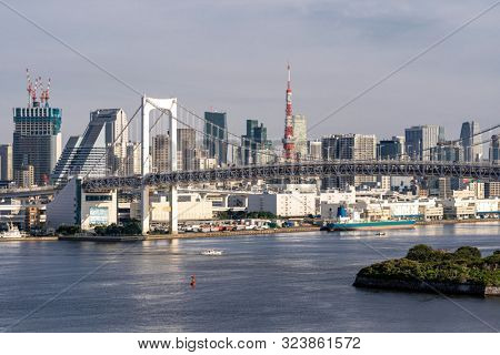 Aerial view of Tokyo skylines with Rainbow bridge and tokyo tower over Tokyo bay in daytime from Odaiba in Tokyo city Kanto Japan.