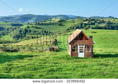 rural wooden farmhouse in Transylvania, Romania