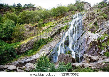 Beautiful Water Cascade Of Powerscourt Waterfall, The Highest Waterfall In Ireland. Famous Tourist A