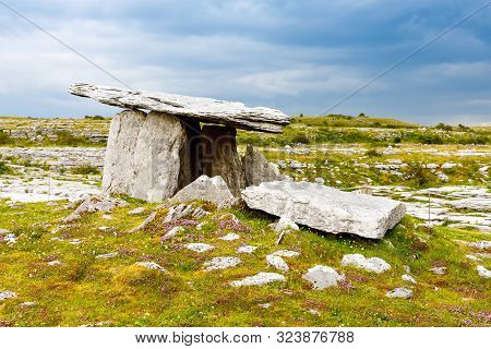 Poulnabrone Dolmen In Ireland, Uk. In Burren, County Clare. Period Of The Neolithic With Spectacular