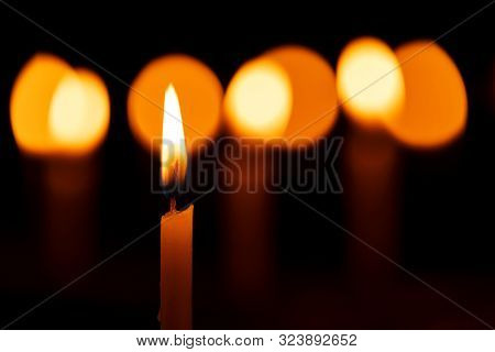 Selective Focus Of A Beautiful Candle Lit During Diwali Festival With Other Candles Creating Light B
