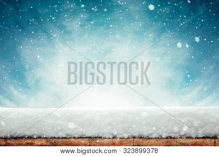 winter Christmas background with snow on the wood