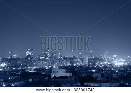 Night View Of The City Life. Light Of The Buildings Shining With Cool Blue Tones. View Of Night Scen